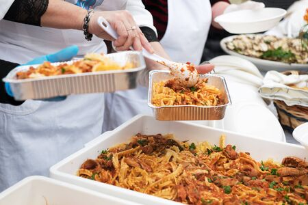 Food for the poor to feed the hungries, concept of food donation, distribution of italian pasta to the needies, help people