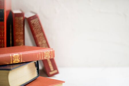 A stack of books on the white background, seletive focus, Education and wisdom concept with copy space Stock Photo