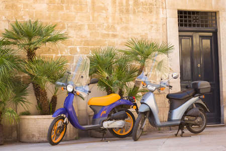 BARI, ITALY - JULY 11,2018, Typical street scene in Bari with a two old scooter on an old narrow cobblestoned street, Apulia, Italy Editoriali