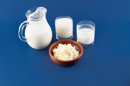 Homemade fermented beverage kefir with kefir grains in bowl. Milk kefir, or bulgaros, is a fermented milk drink made with kefir grains, a yeast bacterial fermentation starter