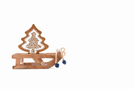 A wooden zero waste small toy sleigh with wooden Christmas tree, New year is coming. Reusable sustainable recycled decor. Eco friendly new year. Flat lay Merry Christmas car
