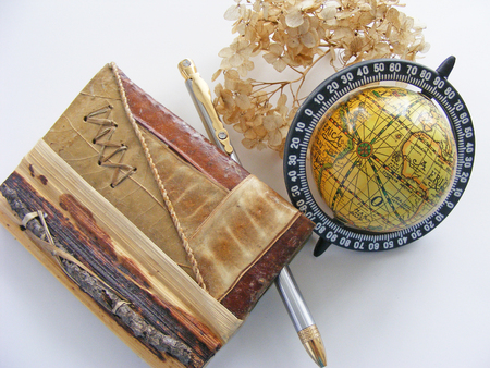 lexicographer: Globe and eco notebook of natural material  twig, leaf, bark  on white background Stock Photo