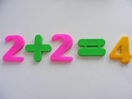 Two plus two equals four Stock Photo