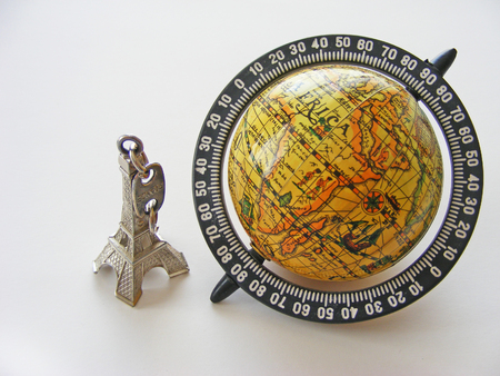 lexicographer: Globe and hold eiffel tower model on white background