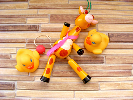 Colorful rattle baby toy on bamboo background Stock Photo