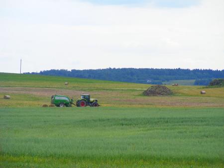 Tractor on farm landscape Stock Photo