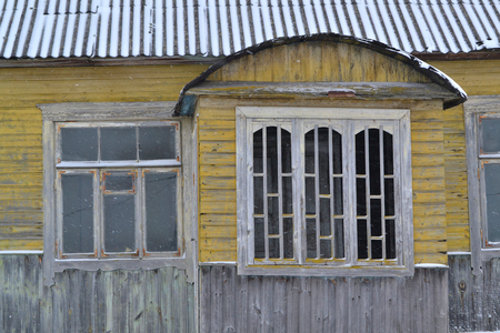Abandoned russian traditional wooden house, shabby interior. Abandoned rustic house. Russian winter. Traditional russian window jamb. Old grunge home