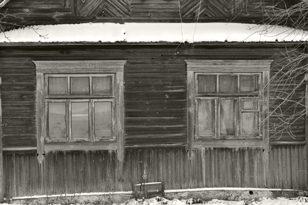 Monochrome image of abandoned russian traditional wooden house in winter day Stock Photo - 116053987