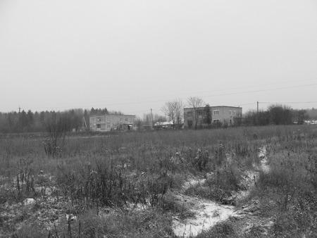 Monochrome photo of slum area housing slum. Natural scene.