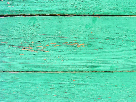 Rustic plank background of green and turquoise, weathered texture with copy space. Green empty wooden background.  Old dirty wall texture. Reklamní fotografie