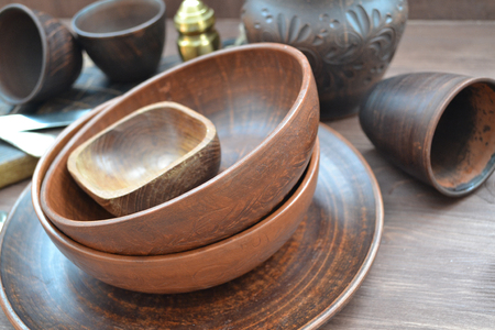 Empty ceramic dishware, silver and wooden objets