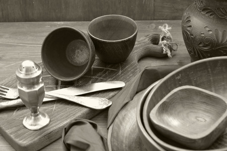 monochrome photo of rustic pottery and home interior decor. Antique crockery Imagens