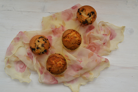 Fresh Tasty Baked Canberry Muffins White Background Tasty Handmade Cupcakes with vintage shawl
