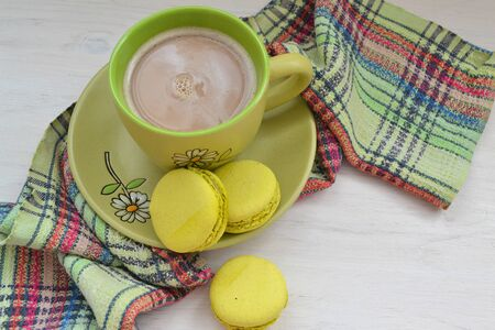 French macaron of pistachios on white shabby background