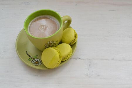 Cake macaron or macaroon and cup of coffee on shabby table with copy space Stok Fotoğraf