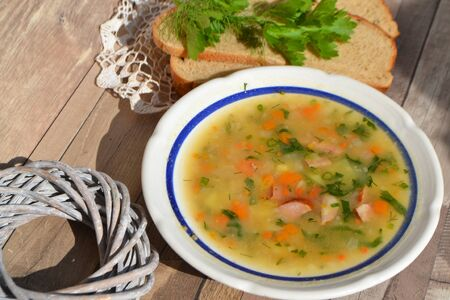 Rustic Nordic Pea Soup on vintage table in village Stock Photo