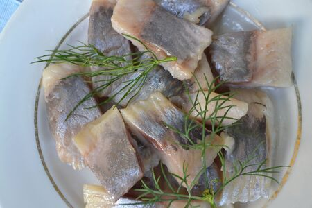 Salted Herring with Spice and dill close up