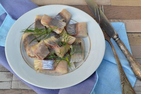 Healthy food concept. Slices of salted herring. Delicious lunch. Reklamní fotografie