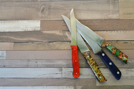 Top view of different knifes on rustic wooden tabletop, with copy space Reklamní fotografie