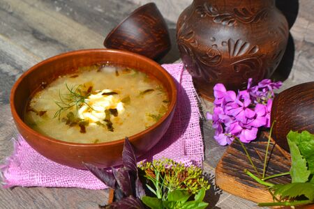 Cabbage Soup Sweet-and-Sour in a ceramic bowl in rustic style