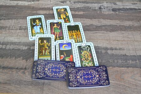 Tarot cards spread displayed on a table.Tarot card of divination, mystic and magic Фото со стока