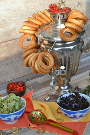 Samovar. Russian tradition of tea drinking. Bagels Russian sweets for tea. Vertical photo