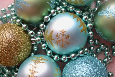 Christmas tree with bauble toys in blue and teal colors. Christmas background