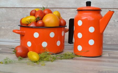 cherry red and yellow tomatoes, red, pan and teapot of russian style in red color with white dots pattern