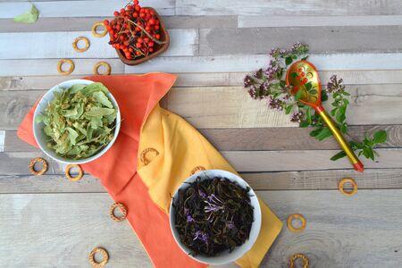 Varius herbal tea, russian cuisine: linden tea, mint, ivan tea (blooming sally) and rowan berries. Rustic table closeup. Herbal essence.  Natural herbs medicine. 스톡 콘텐츠