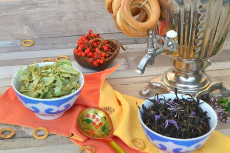 Russian traditional samovar with delicious herbal tea and donuts, bright photo