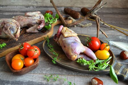 Delicious wild partridge with fresh juicy vegetables on the wooden rustic table. Russian cuisine Zdjęcie Seryjne
