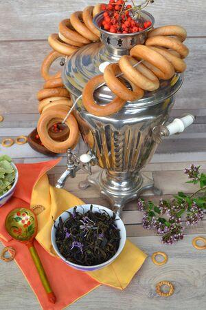 Vintage russian samovar, dry herbal tea with bublik. 写真素材