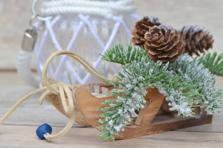 Retro toy sled and candle Christmas decoration closeup