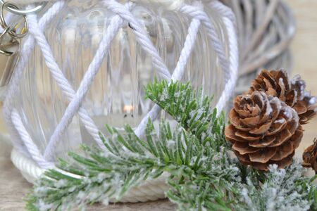Christmas glass candle decorated with tree branch and little cones Stock Photo