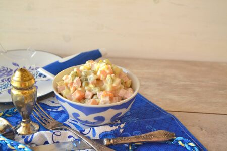 Russian salad Olivier with meat, potatoes, egg, cucumber, onion, mushrooms and mayonnaise. For new year table, Christmas snack. Copy space Stockfoto - 132487713