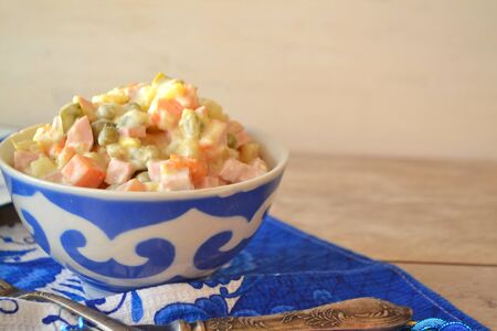 Traditional Russian Olivier Salad, russian gzhel style, copy space