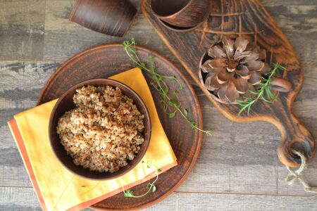 Buckwheat porridge in an old ceramic bowl. Traditional russian cuisine, flat lay Stockfoto - 132487728