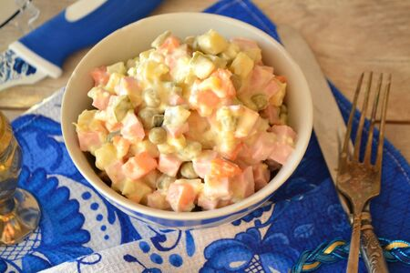 Soviet times popular typical Russian Olivier salad wirh boiled vegetables.