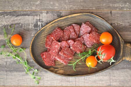 Salami or dry sausage. Russian cuisine. Top view. Stockfoto - 132487733