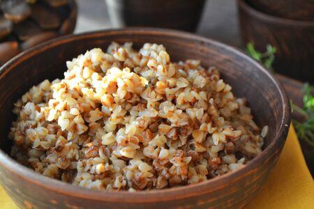 Organic buckwheat porridge in rustic ceramic bowl close up