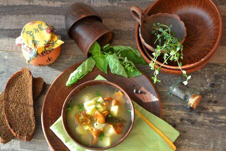 Chanterelles mushroom soup, sunny image of slavic cuisine, top view, flat lay Stock fotó