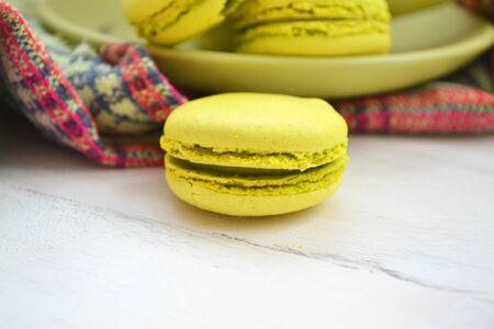 Macro image of a green macaron on a white shabby surface. Stockfoto - 133080722