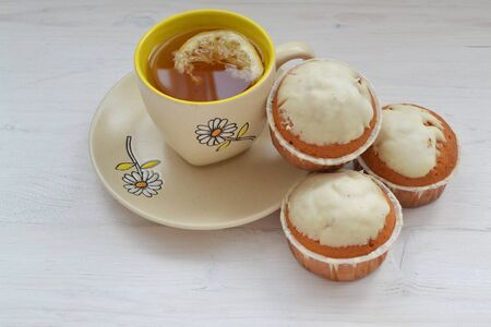 Cupcakes for lifestyle design. Sweet dessert. Party food with cup of tea. Food shabby background.