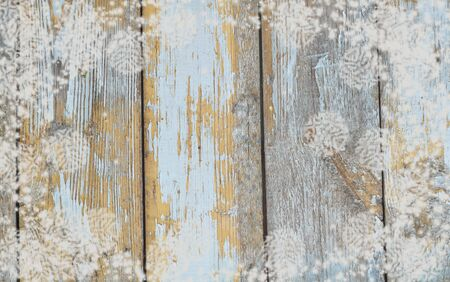 Christmas background with snowflakes on wooden planks texture in teal and turquoise colors