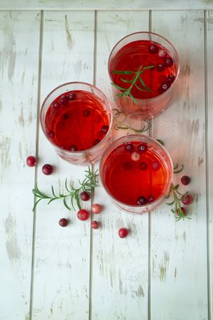 cranberry red drink for Christmas, vertical image, rouge on white