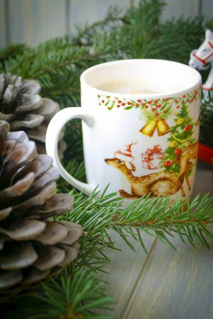 Style life concept card, cup of cappuccino with Christmas tree shape, vertical image