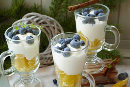 blueberry orange smoothie with cream mousse in a glass jar, pubs, Christmas decoration
