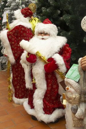 Vintage handmade dolls of Father Frost or Ded Moroz. In a holiday market, vertical image