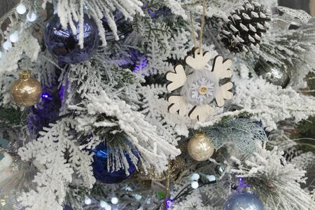Lovely decorated snowy Christmas tree in silver and blue, closeup texture