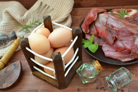 Wild meat of moose game with organic eggs, russian country cuisine